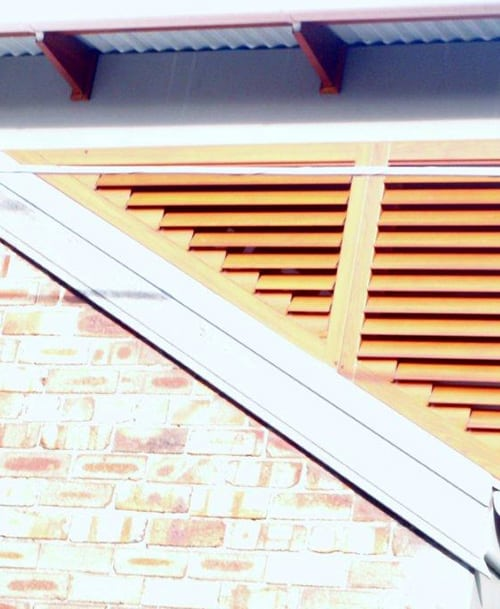 timber look raked aluminium window shutters